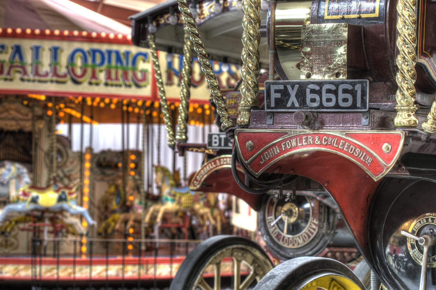 The Iron Maiden Steam engine with the Carousel in background